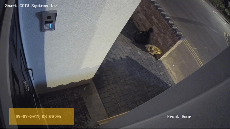 front door footage of our installed CCTV, at 3 AM
